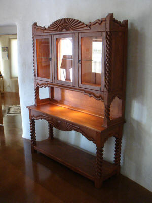 Bear Creek, Southwest Style China Cabinet On Table